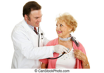 Senior Medical - Heart Health - Doctor using a stethoscope...