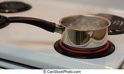 Pot full of boiling water