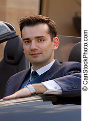 Handsome businessman in cabrio - Attractive young...