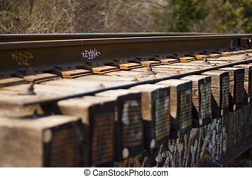Urban Rails - Graffiti tags and spray paint on the side of...