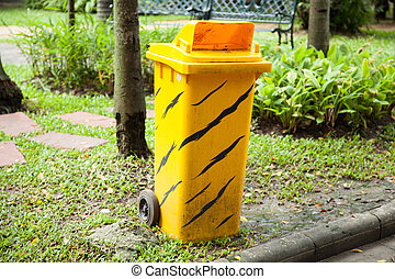 Yellow bins Similar patterned shirt Is set in a park