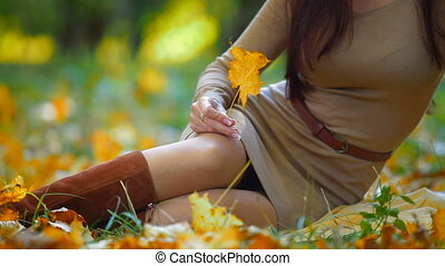 Autumn Female Beauty - Young attractive woman enjoying...