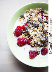 Musli and Raspberries - Bowl with sourmilk, musli and...