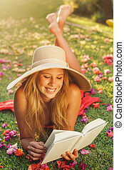 Young Woman Reading Book Outside - Beautiful Young Woman...