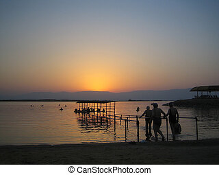 Floating in the Dead Sea at dawn