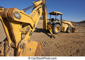 Tractor at a Cunstruction Site and dirt lot