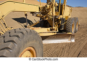 Tractor at a Cunstruction Site and dirt lot.