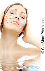gel and scrub - beautiful woman with gel and scrub on face...