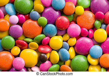 Three different sizes of colorful candies.Colorful...