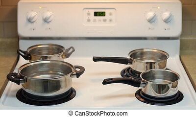 Pots full of boiling water - Four pots full of boiling water...