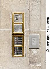 Intercom doorbell panel on stone doorway