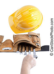 image of a person holding spanner