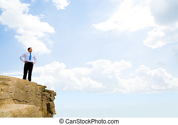 Looking straight - Image of successful businessman standing...