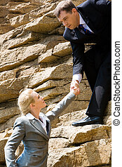 Help - Image of businessman standing on the mount and...