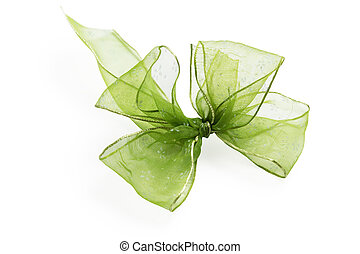 Festive green bow made of ribbon isolated on white
