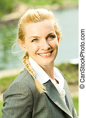 Female - Vertical photo of happy businesswoman looking...