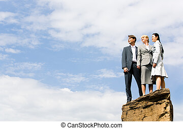 Business group of people standing on the hill and looking...