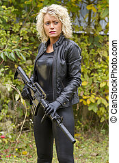 Woman in leather with machine gun