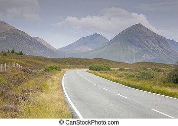 Empty Road with the Cuillin Hills, Isle of Skye, Scotland in the Background