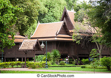 thailand style home.Garden planted with trees and garden.