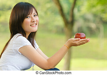 asian girl on apple - beautiful healthy asian girl with an...