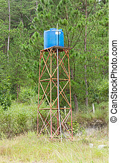 Primitive blue water tower