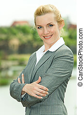 Happy female - Portrait of successful woman looking at...