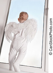 Baby angel in window - Cute baby with angel wings on...