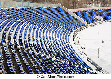 part of a snow-covered stadium, football ground in winter