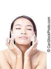 woman washing face with foam - Beautiful woman washing her...