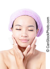 Young Beautiful Girl remove makeup by Cleansing Cotton...