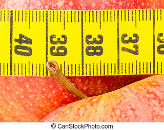 Red apples with a yellow tape-measure