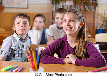 Elementary pupils in classroom during lesson - Elementary...