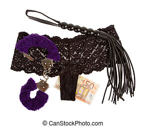 Fluffy purple handcuffs, a whip, money and panties on a...