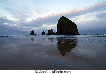 Cannon Beach at Dawn - Pre-dawn view of Haystack rock on...