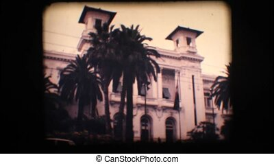 Vintage 8mm. Old casino and palm