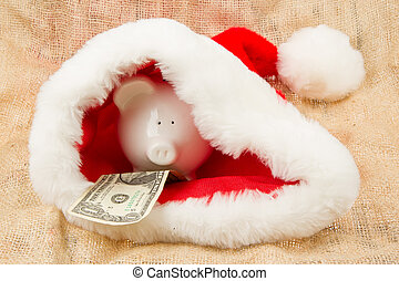 Piggybank guarding Santas crisis budget, one dollar in his...