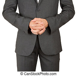 Business man in grey suit praying, isolated on white