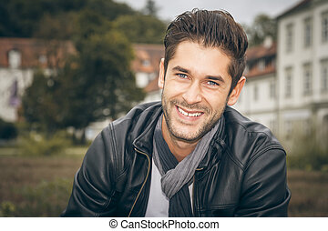 young man outdoor - An image of a handsome man outdoor