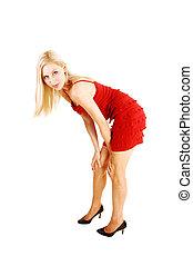 Blond girl bending.