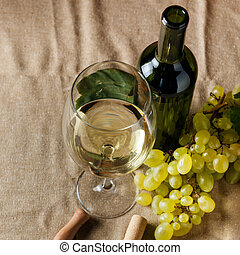 Bottle and glass of white wine - studio shot