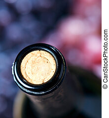 Closeup of wine bottle and cork - studio shot