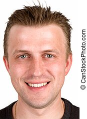 Face close up. - Portrait of the young smiling man. Face...