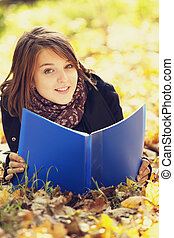 Portrait redhead girl at outdoor. Autumn.
