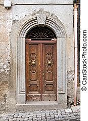 Wooden door. Nepi. Lazio. Italy.