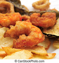 battered and fried shrimps tapas - closeup of a plate with...