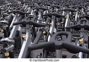 Spinning bikes - Large group of aluminum spinning bikes...