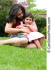 Mother and daughter playing outside - A mother plays with...