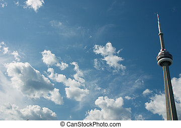 CN Tower across a blue sky - Photo of the CN Tower in...