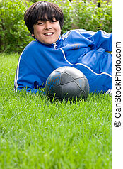 Soccer time - A young boy in the field with his soccer ball